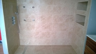 Wetroom installation, floor tiling and splashback design in Neyland